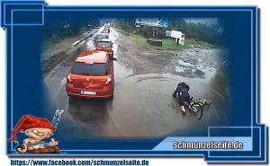 Fahrradfahrer vs. Pfütze